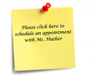 Post it note with Click here to schedule an appointment
